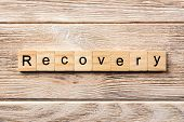 Recovery Word Written On Wood Block. Recovery Text On Table, Concept. poster