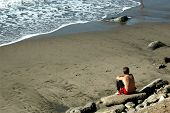 picture of mental_health  - Man sitting on the beach feeling sad and depressed - JPG