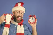 Christmas Man Hold Alarm Clock And Cup. New Year, Xmas Holidays Celebration. Countdown To Midnight.  poster