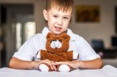 Funny And Naughty Caucasian Child With A Toy Teddy Bear. Happy Childhood Concept. poster