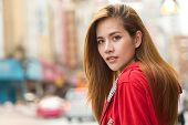 Portrait Of Beautiful Young Asian Women Tourist Traveler Smiling In Red Coat In China Town Yaowarat  poster