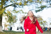 Playful Kid Leisure. Child Blonde Long Hair Walking In Warm Jacket Outdoor. Girl Happy In Red Coat E poster