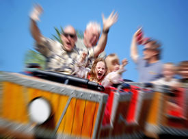 foto of amusement park rides  - Father and Daughter On Amusement Park Roller Coaster with Zoom Blur - JPG