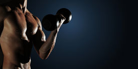 image of lifting weight  - Part of a wet man - JPG