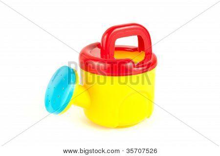 rote und gelbe Kunststoff-Spielzeug Gießkanne