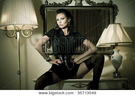 Sexy Beautiful Woman Beside Mirror