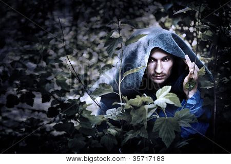 Mystery Man In Raincoat With Hood