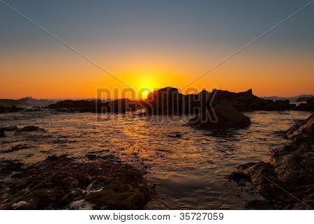 Sunset on the beach rocks