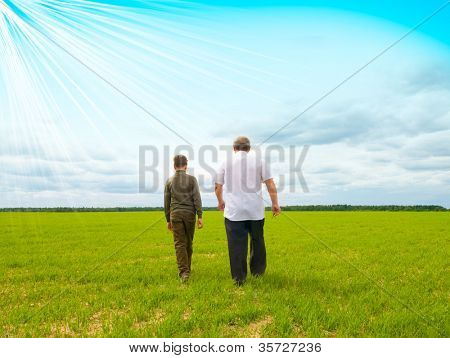 grandson and grandfather in the field