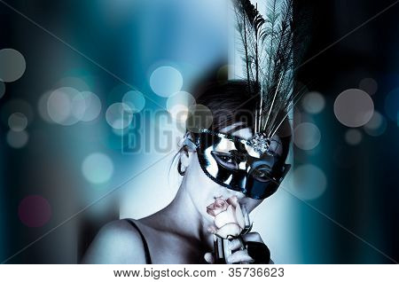 beautiful woman with mask and wine