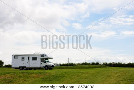 Camper Van On The Camping Ground