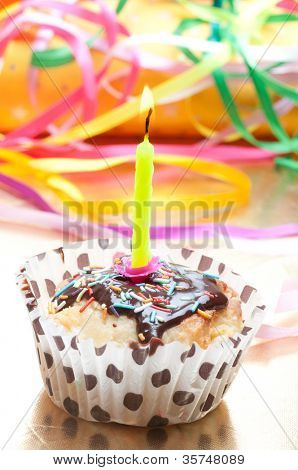 cupcake with sprinkles and candle. birthday