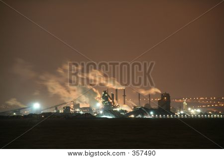 Smoking Industrial Park At Night