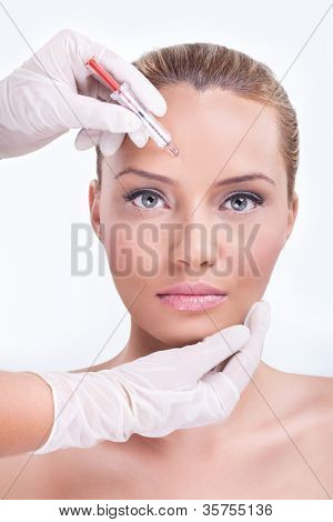 Woman receiving injection in the eyebrow zone