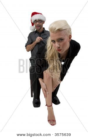 Man Looking Towards Lady With Magnifier
