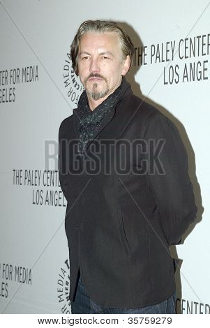 "BEVERLY HILLS - MARCH 7: Tommy Flanagan arrives at the 2012 Paleyfest ""Sons of Anarchy"" panel on Wednesday, March 7, 2012 at the Saban Theater in Beverly Hills, CA."