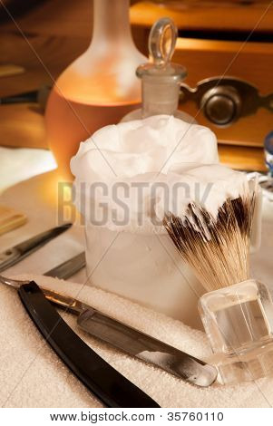 Shaving soap and razor blade in a vintage barber shop