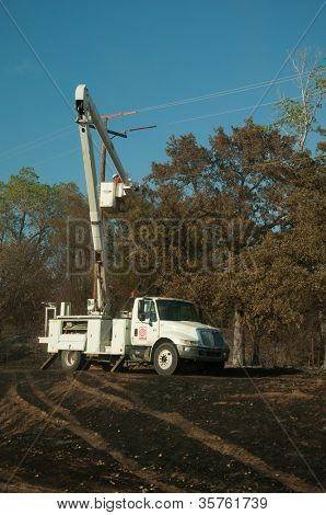 CREEK COUNTY, OKLAHOMA - AUGUST 6 2012: crews restoring power after a massive wildfire  on August 6, 2012 in Creek County, Oklahoma
