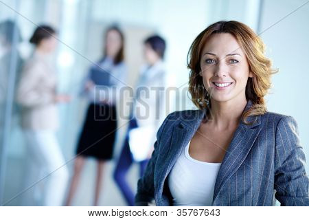 Image of pretty business leader looking at camera