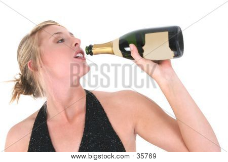 Beautiful Woman Drinking From A Champagne Bottle