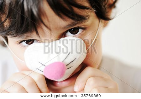 Child portrait wearing cat mask