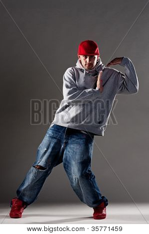 studio shot of cool b-boy over dark background