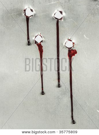 bloody gunshot holes with blood drips