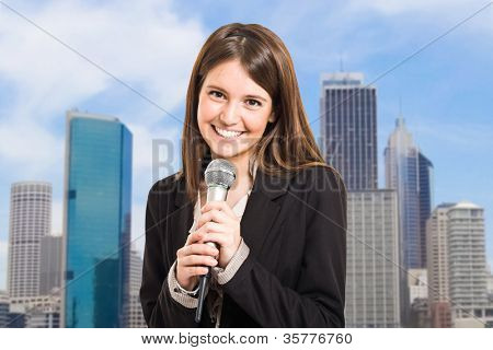 Portrait of a woman speaking in a microphone
