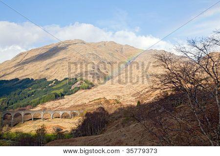 Glenfinnan Viaduct Railway Station with rainbow in Scotland UK