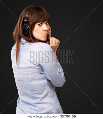 Woman With Headphones And Pouted Lips Isolated On Black Background