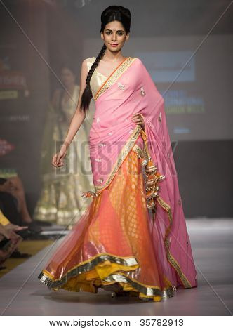 CHENNAI - JULY 21: A model walks on the ramp showcasing designer Anuradhaa Bisani work during the Chennai International Fashion Week runway on Jul 21, 2012 in Chennai , India.