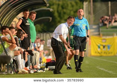 KAPOSVAR, HUNGARY - AUGUST 4: Laszlo Prukner (Kaposvar trainer) in action at a Hungarian National Championship soccer game Kaposvar (white) vs Debrecen (red) August 4, 2012 in Kaposvar, Hungary.