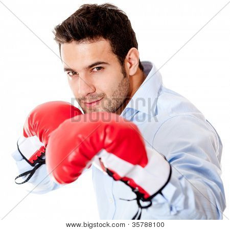 Business man ready to fight with boxing gloves - isolated over white background
