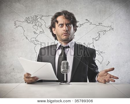Anchorman reading the news into the microphone [Elements of this image furnished by NASA]