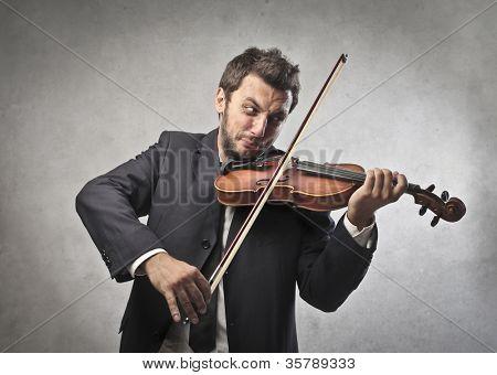 Elegant young man playing the violin