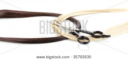 Shiny blond and brown hair with hair cutting shears isolated on white