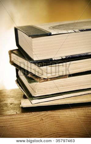 a pile of books on a desk symbolizing the concept of reading habit or studying