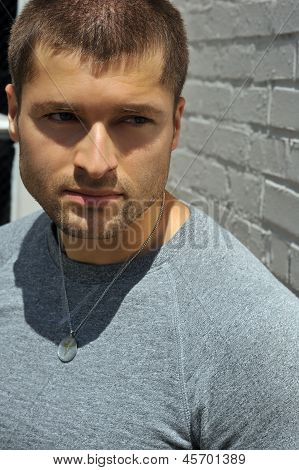 Male actor headshot showing action movie character