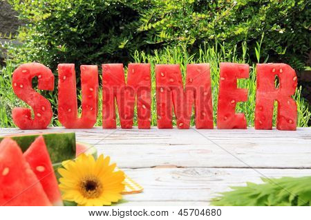 Summer spelled in letters cut out of watermelon.