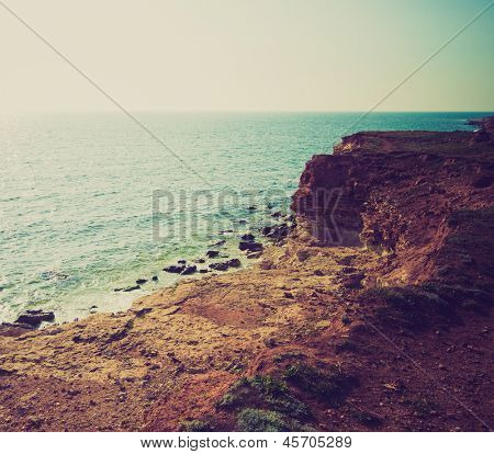 beautiful view of sea cost and rocks in retro colors