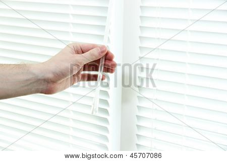Someone opens blinds