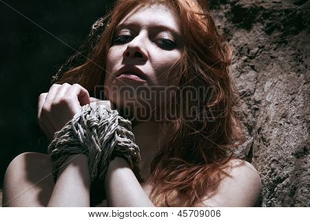 nude redhaired woman bondage in subterranean