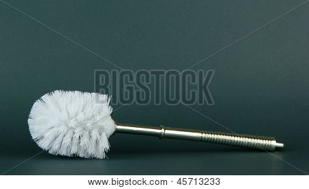 Toilet brush on grey background