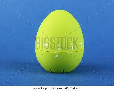 Green egg timer, on color background