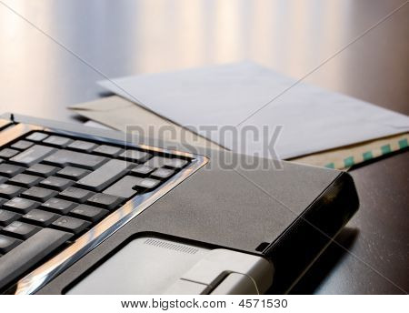Laptop And Letters On A Desk
