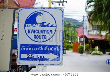 "PHUKET, THAILAND - MAY 11: ""Tsunami Evacuation"" sign on May 11, 2013 in Phuket, Thailand. In 2004, during the tsunami in Phuket drowned 5,300 people"