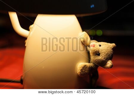 Gray Squirrel Doll Clinging To The Mushroom Lamp