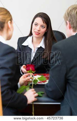 Mortician is advising clients for the funeral and is giving them solace