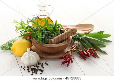 fresh herbs with mortar and pestle