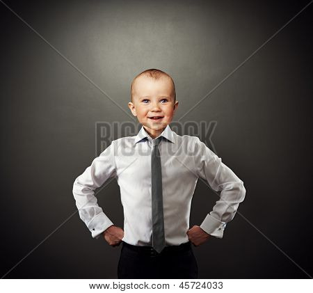 funny photo of successful business baby over dark background